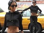 Traffic stopper! Rihanna parades her sexy six-pack abs in short top and skintight trousers to hail a cab in New York
