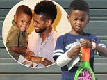 Bouncing back: Usher's resilient young son steps out sporting a large bandage on his right arm at children's play centre one week to the day after terrifying near-death ordeal