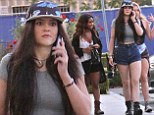 Kylie Jenner looks low key but stylish in grey crop top and denim hot pants for lunch out with friends