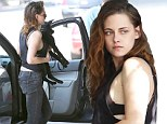 Bra-vo! Kristen Stewart flashes her lingerie as she heads into a restaurant with her dog
