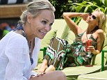 It's a hard life! Kristin Chenoweth cools down with an iced drink as she soaks up the sun poolside in Miami