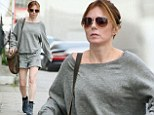 Dress the way that you feel! Geri Halliwell looks glum as she steps out make-up free in all-grey ensemble