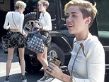 She loves to show skin: Miley Cyrus revealed her sculpted physique in a crop top and floral skirt as she headed to the studio in Studio City, CA on Tuesday