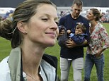 Football's first family: Gisele Bundchen and Tom Brady put on a touching display as they lavish son Benjamin with attention at Patriots NFL training camp