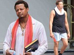 No more Hustle, only Flow: Terrence Howard sports a tight tank... as he reads up on New Age spirituality following ex's restraining order for wife-beating