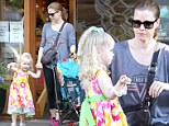 She's like a rainbow! Make-up free Amy Adams blends into the background as little Aviana shines in multicoloured dress