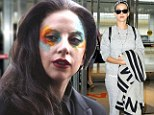 Desperate Lady Gaga STILL wearing garish war paint to plug new song...as chart rival Katy Perry looks carefree in sloppy tracksuit