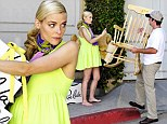 Ding dong, baby delivery! Barefoot and heavily pregnant Jaime King stands out in a neon dress as she receives essentials for her unborn child's nursery