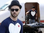 He loves the high life! Justin Timberlake leaves private jet wearing heart printed T-shirt