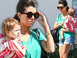 Kourtney Kardashian keeps cool in shorts on daycare run with baby Penelope as she shrugs off latest paternity claims