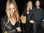 Didn't pack anything else? Rosie Huntington-Whiteley recycles her favourite leather jacket for date night with Jason Statham