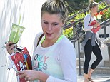 Green for go! Sporty Ireland Baldwin wears neon sports top to grab healthy green juice before hitting the books at study session