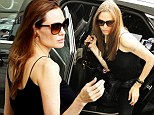 Let's hope Jennifer Aniston isn't on the flight! Slender Angelina Jolie jets out of London with son Maddox...after narrow run-in with former love rival