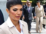 Show of solidarity: Real Housewives' Teresa Giudice and husband Joe arrive hand-in-hand at court as pair plead not guilty in financial fraud case