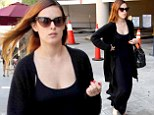 Rumer Willis is a dark lady as she sweeps down the road dressed head-to-toe in black