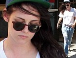 Shady lady: Kristen Stewart leaves a bank in Los Angeles with broken sunglasses