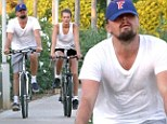 Wheel love? Leonardo DiCaprio and model girlfriend Toni Garrn take a bike ride together on holiday in Mallorca