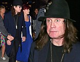 Night out: Ozzy Osbourne takes his wife Sharon Osbourne out for a meal in New York