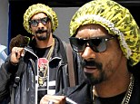 Where's that famous mane? Snoop Lion keeps his dreads tidy under a frilly yellow shower cap as he arrives in Greece