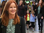 Beam me up! Marcia Cross sends out the happy vibe as she jets out of Los Angeles with her healthier husband and their twins