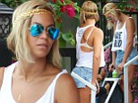 Singer Beyonce shows off her new hair extensions leaving 'Sylvano Ristorante Italiano' in Miami Beach