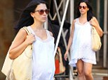 She's doing it the white way! Hilaria Baldwin gives a lesson in maternity dressing as she wears pretty white dress for city stroll as due date approaches