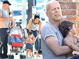Daddy duty: Bruce Willis and his wife Emma Heming change their baby daughter Mabel in Los Angeles