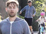 Cue training montage! Tobey Maguire jogs alongside his daughter Ruby, 6, as she gets to grip with her new bike