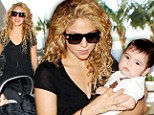 Frequent flyers! Shakira looks fresh-faced as she arrives at the airport with son, Milan