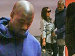 PICTURE EXCLUSIVE: Cheer up, Kanye! West looks glum as he heads out with Kim and baby North... and can't resist turning a critical eye to Kardashian's outfit