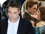 Did Robert Pattinson slam his Twilight fans? The vampire hunk says he 'wonders what these masses of people do all day'