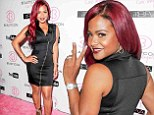 All dolled up: Christina Milian pours her curves into figure-hugging LBD as she rocks the pink carpet at BeautyCon event