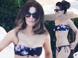 Kate Beckinsale shows off her yoga-honed body while lounging poolside with husband Len Wiseman during Mexico getaway