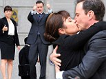 How would you rate that? Tiffani Thiessen gets into her role as she shares a loved-up kiss with co-star Tim DeKay on TV set