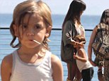 Growing so fast! Kourtney Kardashian's son Mason was over half her 5ft height as he leaned in to give her a hug at Nobu in Malibu, California on Thursday