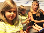 Busy Philipps treats her mini-me daughter Birdie to a new doll as they enjoy a shopping trip together