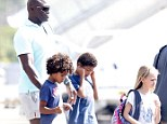 Reunited with daddy! Seal and his brood board a light aircraft after holiday in Sardinia... as ex-wife Heidi Klum continues to enjoy alone time with her boyfriend