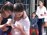 Look who's growing up! Katie Holmes enjoys a break from filming with her elegant little lady Suri Cruise