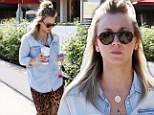 Reow! Kaley Cuoco channels her inner animal as she stakes out her morning coffee in leopard print pants