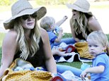 You want some? Hilary Duff's generous boy Luca feeds his mom a snack during picnic at the park