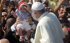 The Pope blessing a baby