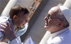 Pope Francis blesses a child in St Peter's Square