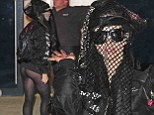 That ought to create a buzz! Lady Gaga covers her face with a beekeeper net... but can't resist flashing her bottom