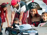 Taking the helm! Snooki lets her son sit behind the wheel of a toy car at his pirate themed first birthday party