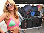 Paris Hilton's bags arrive at LAX and they barely fit in the truck to take to her home.