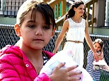 Suri Cruise is recovering from breaking her arm, it was revealed on Friday.
