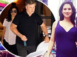 Ready to get this show on the road! Hilaria Baldwin, left, and Alec Baldwin, right, took their newborn daughter Carmen out for a weekend getaway from New York City on Friday