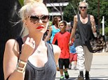 Gwen Stefani drowns her slender frame in baggy get-up as she takes sons to museum for educational day out