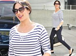 Happy traveller! Lauren Silverman wears Breton stripes to travel home after a romantic two days with Simon Cowell