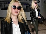 She's all grown up! Dakota Fanning sports a polished look in leather trousers as she heads out of LAX in style